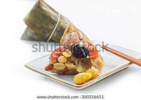 Asian Chinese rice dumplings or zongzi on white background - stock photo