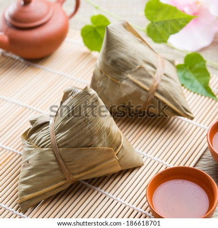 Asian Chinese rice dumplings with tea - stock photo