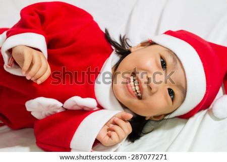 Asian Chinese santa girl in white background - stock photo