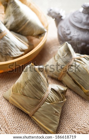 Asian Chinese tradition food - steamed rice dumpling with tea. - stock photo