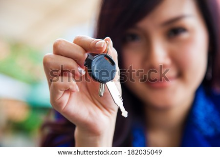 Asian Chinese Woman holding new home keys - stock photo