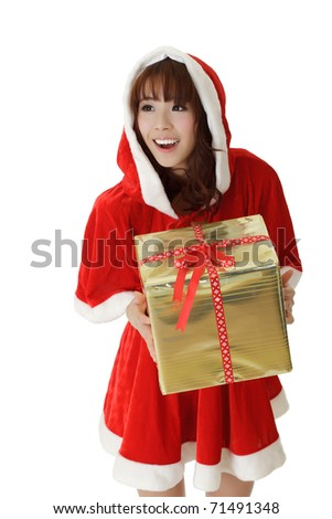 Asian Christmas girl holding gift with happy smiling expression. - stock photo