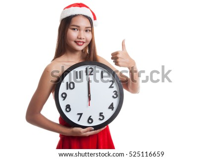 Asian Christmas Santa Claus girl  thumbs up and clock at midnight  isolated on white background.