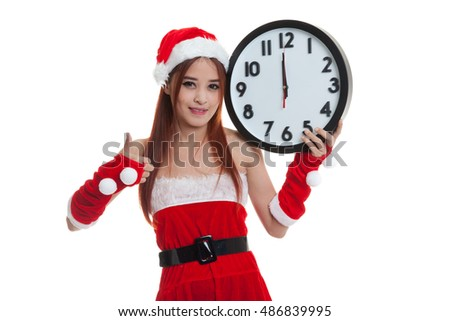 Asian Christmas Santa Claus girl   thumbs up  with clock at midnight  isolated on white background.