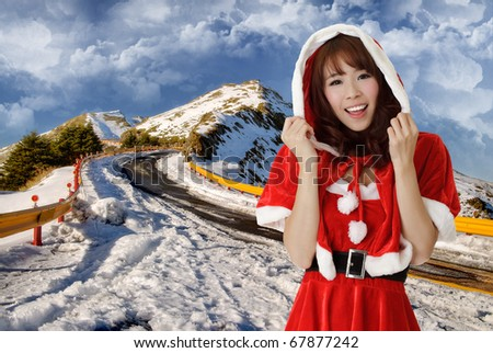 Asian Christmas woman in outdoor of mountain with snow. - stock photo