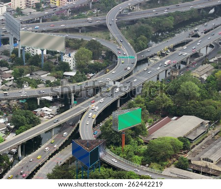 Asian city with overpasses and viaducts, view from the heights - stock photo
