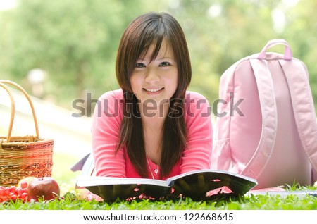 asian college student studying outdoor	 - stock photo