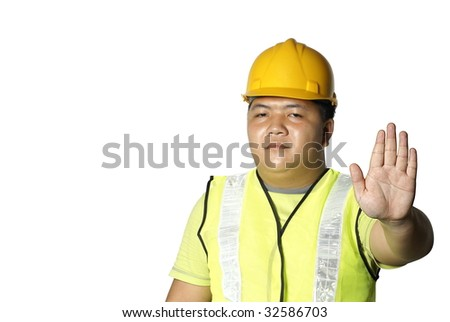 Asian construction worker with stop hand signal on white background