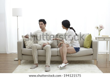 Asian couple arguing