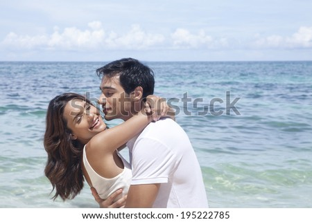 Asian couple by the sea in Boracay in the Philippines