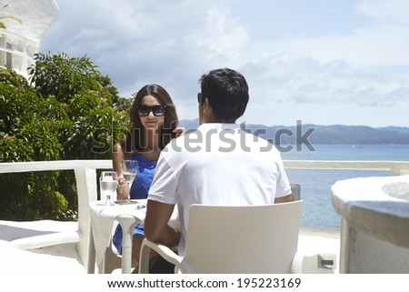 Asian couple eating by the sea in Boracay in Philippines