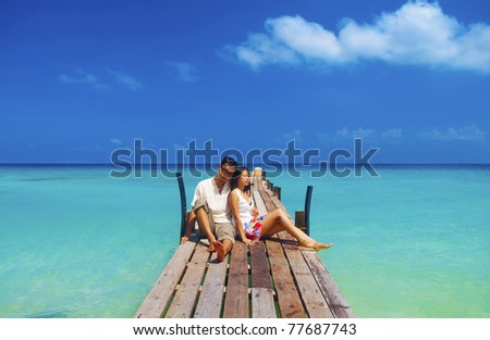 Asian couple having a great time at the island, Lang Tengah, Malaysia