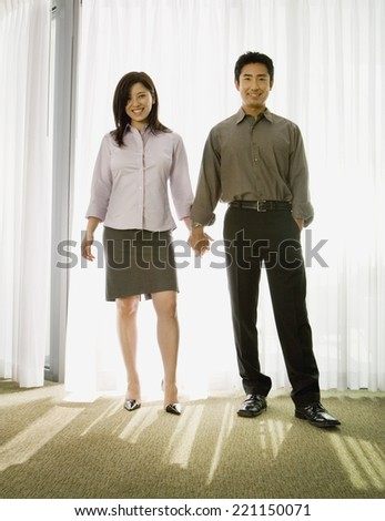Asian couple holding hands