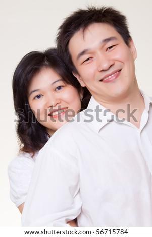 Asian couple hugging white shirt on white background - stock photo