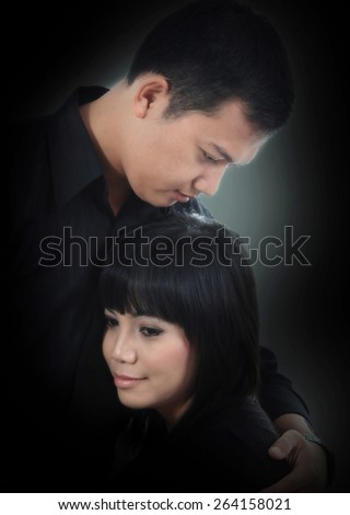 asian couple in black - stock photo