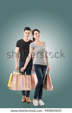 Asian couple shopping, full length portrait isolated - stock photo