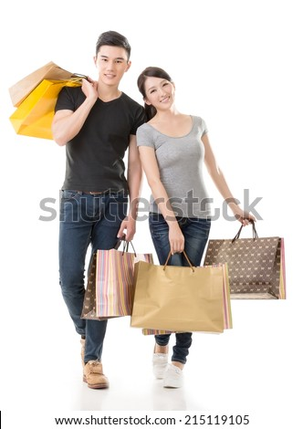 Asian couple shopping, full length portrait isolated on white background. - stock photo