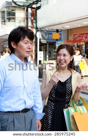 Asian couple shopping together