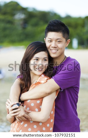 Asian couple smiling - stock photo