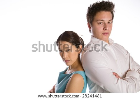 Asian couple standing back to back isolated against white background