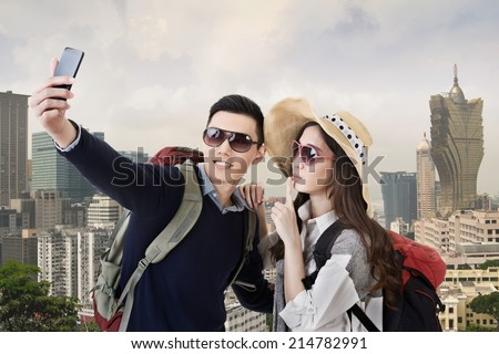 Asian couple travel and selfie in Macau, Asia.