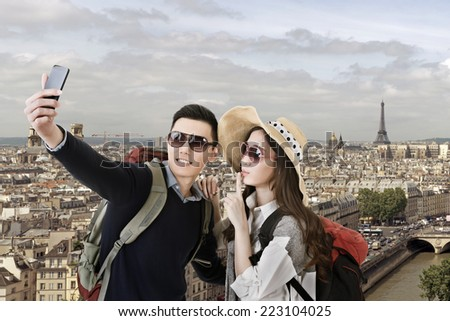 Asian couple travel and selfie in Paris, France. - stock photo