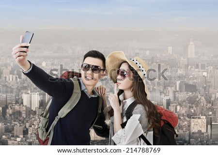 Asian couple travel and selfie in the city. - stock photo