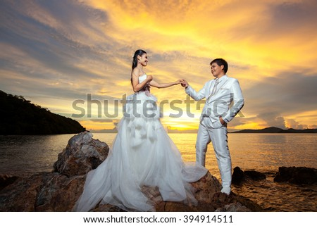 Asian couple with pre wedding against sunrise  - stock photo