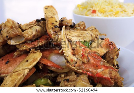 asian crab legs cooked with vegetables, served with rice