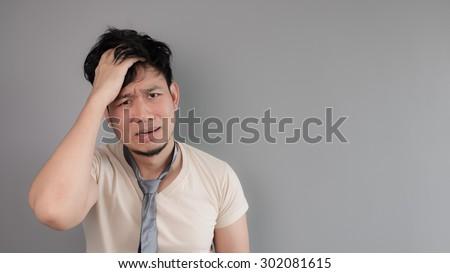 Asian crazy employee with his bad necktie. - stock photo