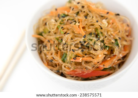 Asian Cuisine Inspired Kelp Noodle Salad with Vegetable and Sesame Seeds - stock photo