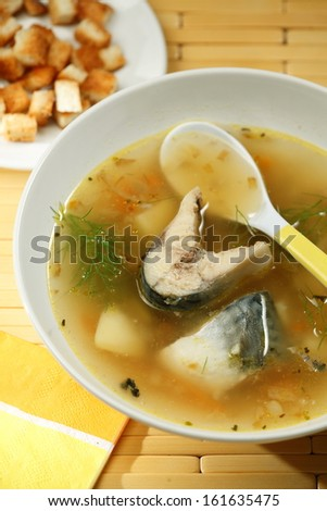 Asian cuisine: Tai fish soup with mackerel and ginger - stock photo
