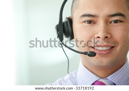 asian customer service representative man in an office - stock photo