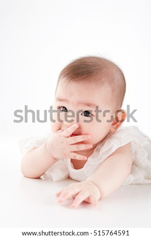 Asian cute baby Portrait of a crawling baby in white background