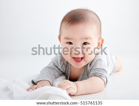 Asian cute baby, shot in studio white background