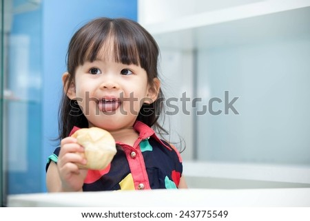 Asian cute girl eating bread