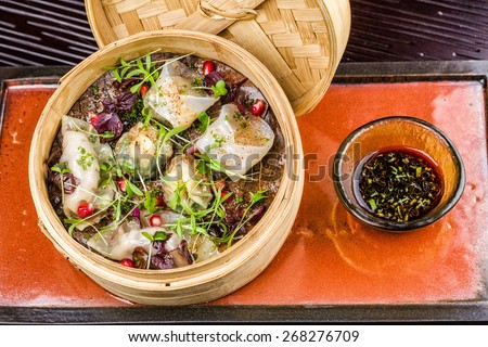 Asian delicious dumplings served in the wood plate - stock photo