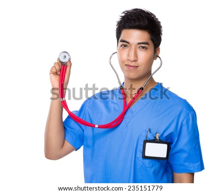 Asian Doctor hold with stethoscope - stock photo