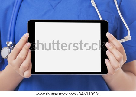 Asian doctor or nurse holding a tablet computer.  With a Clipping path, ready to add text or copy