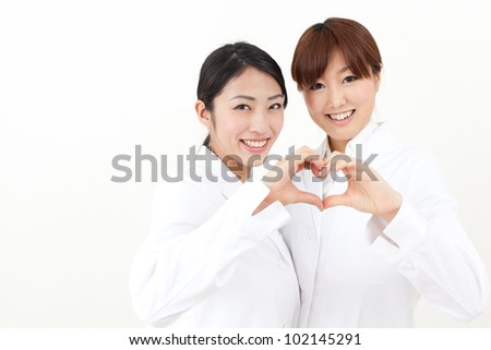 asian doctors showing a symbol of heart - stock photo