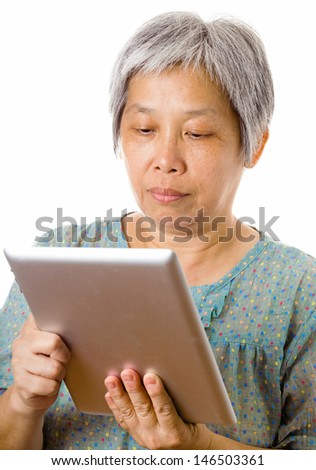 Asian elderly using tablet