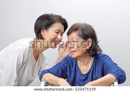 Asian elderly woman hearing loss , Hard of hearing.