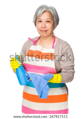 Asian elderly woman use of detergent fo cleaning  - stock photo