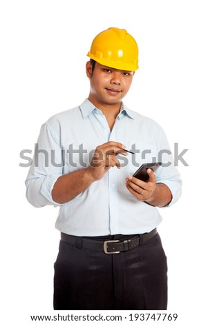 Asian engineer man hold a cellphone and a pen isolated on white background