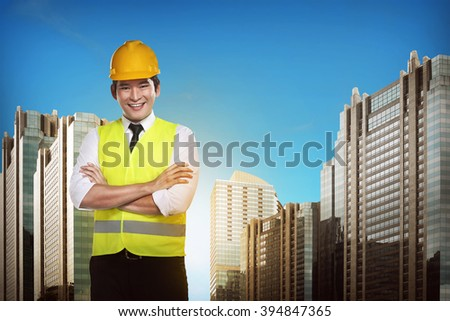 Asian engineer wearing safety vest. Industrial concept - stock photo