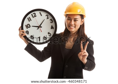 Asian engineer woman show victory sign with a clock  isolated on white background. - stock photo