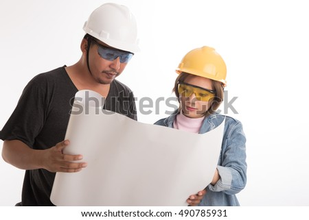 Asian engineer woman talking with enginneer man about job with blueprints on white background.