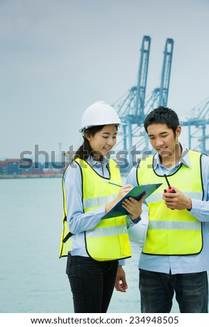 Asian engineers  working men and women standing on the dock exports - stock photo