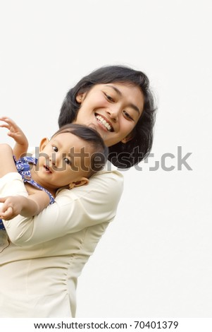 Asian ethnic family portrait of working mom embrace her little daughter - stock photo