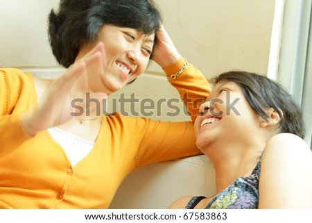 Asian ethnic mother enjoy having conversation with teenage daughter